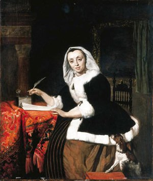 An elegant lady writing at her desk, with a dog beside her